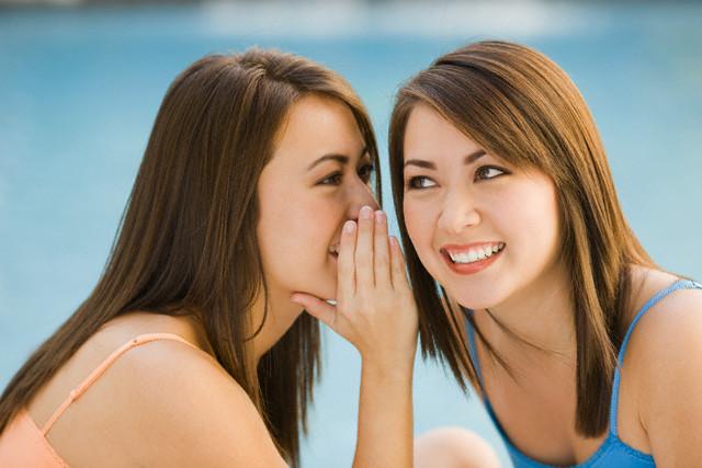 Twin Sisters Telling Secrets